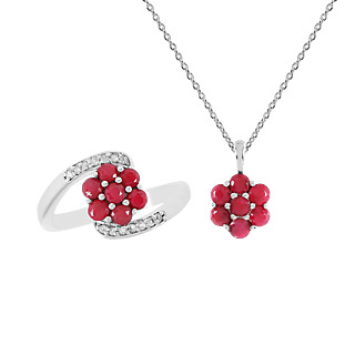 Une floraison de rubis. Argent 925 rhodié 14 rubis traités 14 zircons naturels Chaîne maille forà§at.
