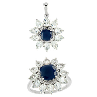 Une marque d'élégance. Argent 925 rhodié 2 saphirs traités 2.33cts 22 topazes incolores 4.40cts 2 éclats de diamant.