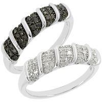 Une bague offerte En diamants noirs. Argent 925 rhodié 40 diamants blancs 0.25ct 40 diamants noirs 0.25ct.